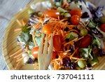 fresh salad on a wooden plate   Shutterstock . vector #737041111