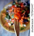 fresh salad on a wooden plate   Shutterstock . vector #737041447