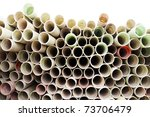 stack of plastic pipes isolated on white - stock photo