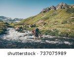 Traveler Man Crossing River At...