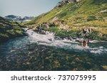 traveler man crossing river at... | Shutterstock . vector #737075995