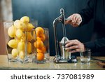 the hand juicer. the man ... | Shutterstock . vector #737081989