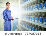 asian man in blue coverall suit ... | Shutterstock . vector #737087395