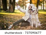 girl with dog | Shutterstock . vector #737090677