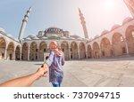 follow me. a muslim woman in a... | Shutterstock . vector #737094715