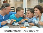 father and sons having breakfast | Shutterstock . vector #737109979