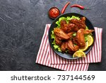 smoked chicken wings with... | Shutterstock . vector #737144569