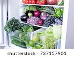 opened refrigerator full of... | Shutterstock . vector #737157901