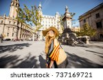 young woman tourist walking... | Shutterstock . vector #737169721