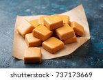 homemade caramel candy on the... | Shutterstock . vector #737173669