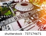 dj cd player and mixer in a... | Shutterstock . vector #737174671