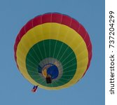 Small photo of Morning Assent. Hot air balloon ascending in the early Morning.