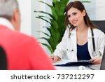doctor talking to her patient... | Shutterstock . vector #737212297