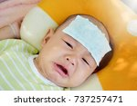 the baby is feverish and crying.... | Shutterstock . vector #737257471
