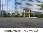 empty road with modern... | Shutterstock . vector #737293969