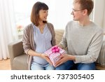 pregnancy  holidays and people...   Shutterstock . vector #737305405