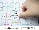hand holding last piece of... | Shutterstock . vector #737332795