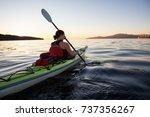 Woman On A Sea Kayak Is...