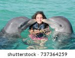 happy girl swimming with... | Shutterstock . vector #737364259