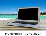 laptop computer on wooden table....   Shutterstock . vector #737368129