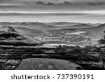 Small photo of Black and White picture of the Prebischtor which is a narrow rock formation located in the Bohemian Switzerland in the Czech Republic
