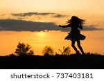 silhouette of a girl dancing at ... | Shutterstock . vector #737403181