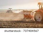 tractor plowing fields  ... | Shutterstock . vector #737404567