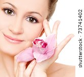 beautiful woman with orchid... | Shutterstock . vector #73741402