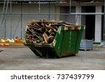 loaded dumpster near a... | Shutterstock . vector #737439799