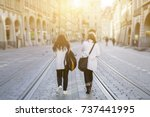 back view of two friends... | Shutterstock . vector #737441995