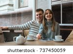 young nice couple sitting in... | Shutterstock . vector #737450059