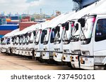 trucks in a row with container... | Shutterstock . vector #737450101