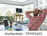 smiling designer with hands... | Shutterstock . vector #737451631