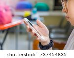young girl holding mobile phone ... | Shutterstock . vector #737454835