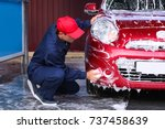 Man Cleaning Automobile With...