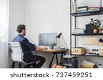 young man working on his... | Shutterstock . vector #737459251