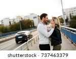 happy young couple hugging and... | Shutterstock . vector #737463379