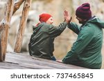 father and son in raincoats...   Shutterstock . vector #737465845