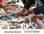 Small photo of A woman bargaining a price at a bracelet store