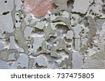 Small photo of Fragment of the brick wall. Empty abstract background of weathered surface of a red brick wall, gray plaster with elements of weather damages, age-related damage.