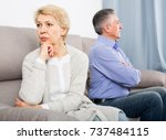 sad middle aged couple... | Shutterstock . vector #737484115