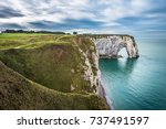 white cliffs of etretat and the ... | Shutterstock . vector #737491597