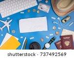 travel objects flatlay on blue... | Shutterstock . vector #737492569