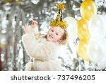 little beautiful girl at a... | Shutterstock . vector #737496205