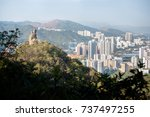 Small photo of Amah Rock, with Shatin new town in the background, at Lion Rock Country Park, Hong Kong