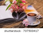 a cup of coffee  flowers and a... | Shutterstock . vector #737503417