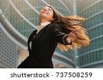 a businesswoman in a business... | Shutterstock . vector #737508259