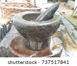 mortar stone for cooking. | Shutterstock . vector #737517841