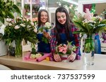 female florists are creating... | Shutterstock . vector #737537599