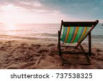 couple beach chair on the beach ... | Shutterstock . vector #737538325